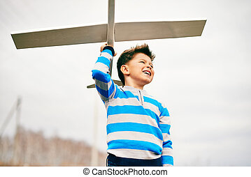 Playing with toy airplane