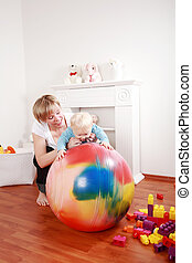 Lovely boy playing with his mother