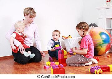 Playtime - Kids in kindergarten with their teacher