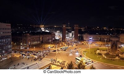 Plaza de Espana in Barcelona, top view at night, traffic...