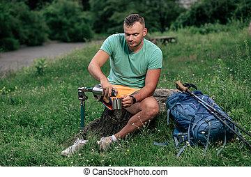 Pleasant active man with prosthesis enjoying tourism