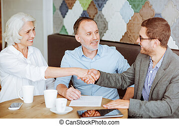 Pleasant aged couple meeting with sales manager - Deal....