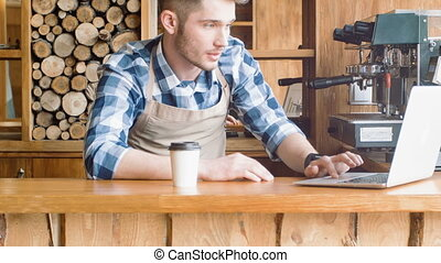 Pleasant barista standing at the counter