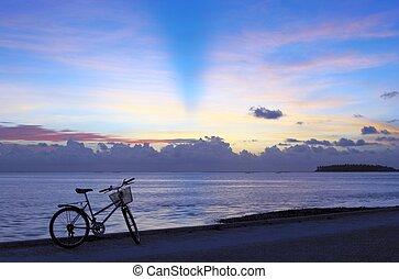 Pleasant bicycle walk along The Indian Ocean. Maldives