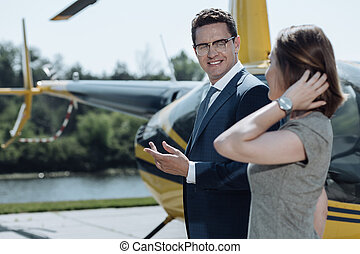 Pleasant business partners talking while preparing for flight