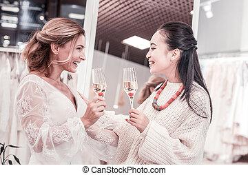 Joyful nice women talking about future wedding - Pleasant...