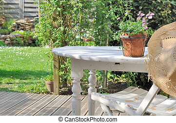pleasant countryside garden - flower pot in a white wooden...