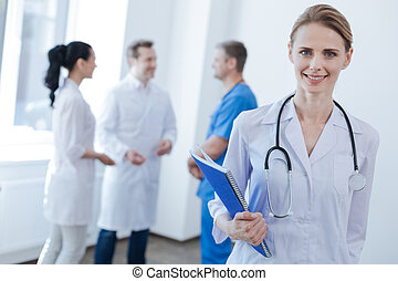 Pleasant doctor enjoying working hours at the clinic