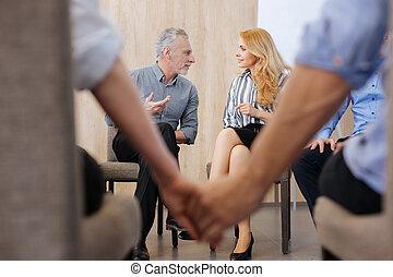 Pleasant elderly man having a conversation