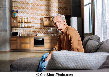 Pleasant elderly man resting at home