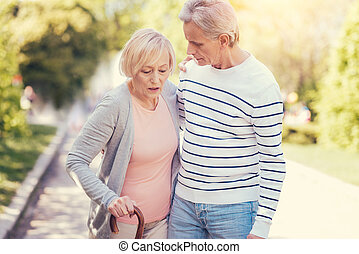 Pleasant elderly woman walking with her husband