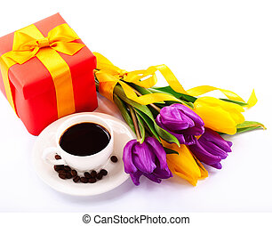 Pleasant evening. Flowers and red gift box. Cup of coffee Close-up.