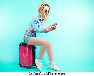 pleasant fair-haired woman using her cell phone