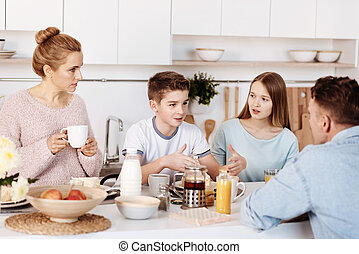 Pleasant family having lively conversation - Lively...
