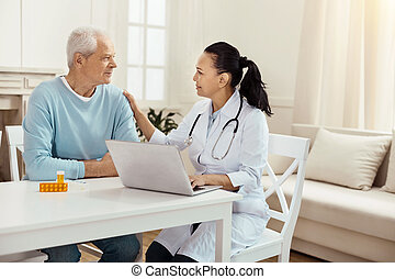 Pleasant female doctor supporting her patient
