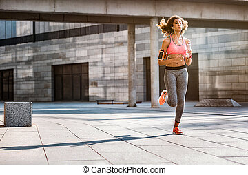 Pleasant fit woman enjoying her morning run