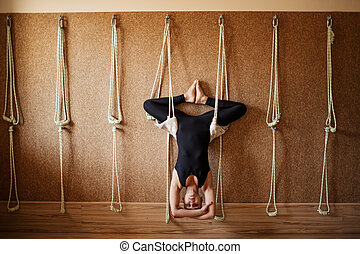 pose of yoga upside down girl in the studio doing