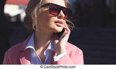 Pleasant girl in sunglasses with fashion look outdoor.