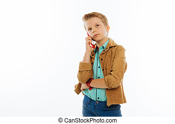 Pleasant good looking boy making a phone call