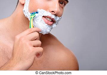 Pleasant guy shaving
