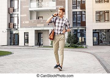 Pleasant handsome man walking