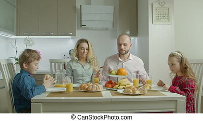 Pleasant happy family having morning meal together -...