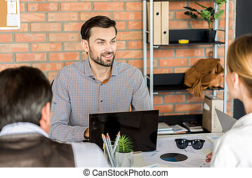 Pleasant joyful employees working together in office - Lets...