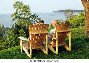 Pleasant Lakeside View - A senior man and woman enjoying a...