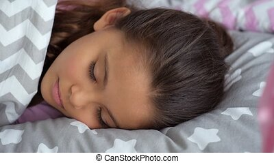 Pleasant little girl sleeping at home