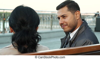 Pleasant man and woman are engaged in a dialogue - A woman...