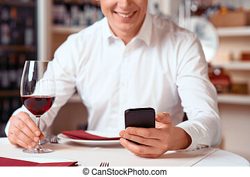 Pleasant man resting in the restaurant
