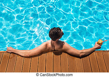 Pleasant man resting in the swimming pool