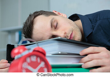 pleasant man sleeping in the office