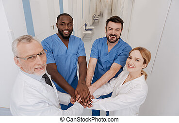 Pleasant medical team enjoying cooperation in the hospital