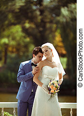 Pleasant moment of the couple in the wedding day
