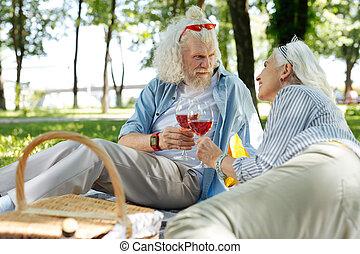 Pleasant nice couple having a celebration