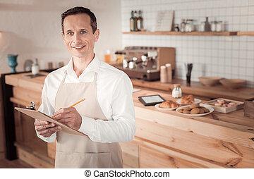 Pleasant nice man taking the order