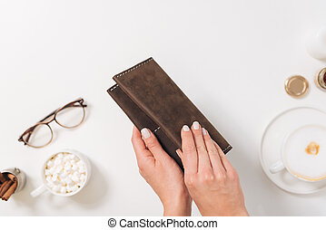 Pleasant nice woman opening a wallet
