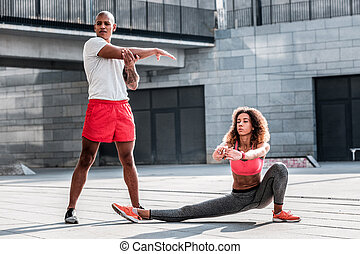 Pleasant nice young people working out together