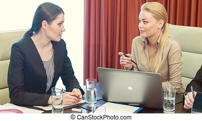 Pleasant professional business colleagues sitting in the conference room