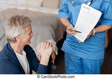 Pleasant qualified therapist giving her patient a little lecture