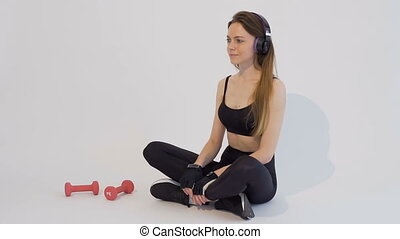 Pleasant Relax after Workout - Dark hair girl, wearing a...