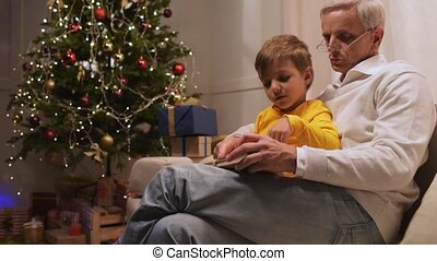 Pleasant retired man preparing presents with his grandson