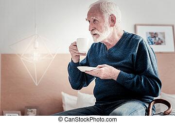 Pleasant senior man having rest
