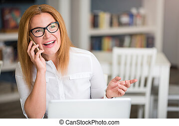 Pleasant senior woman talking on cell phone