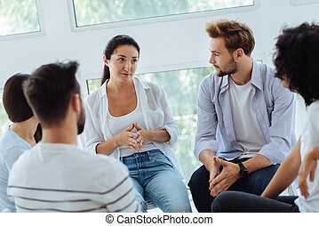 Pleasant smart therapist having a group session