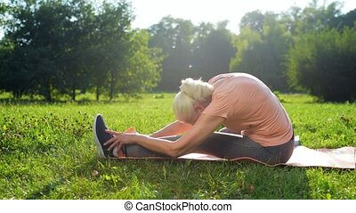 Pleasant sporty woman stretching her body - Load your...