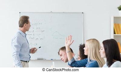 Pleasant teacher conducting the lesson