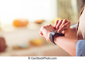 Pleasant woman using smart watch
