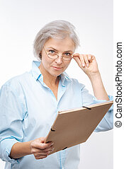 Pleasant woman with folder looking at camera